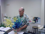 Florist William Yost Jr. arranging flowers in his shop